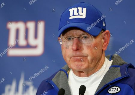 New York Giants coach Tom Coughlin answers questions during a news conference after the team's NFL football game in East Rutherford, N.J. Coughlin, who stepped down as coach earlier this year, will be joining the NFL's football operations staff, a person with knowledge of the agreement tells The Associated Press. The two-time Super Bowl-winning coach will work closely with Troy Vincent and with the NFL's game-related committees in an advisory role