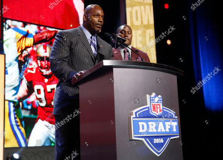 Bryant Young, Takeo Spikes Former NFL players Bryant Young and Former Walter Payton Men of the Year Takeo Spikes announce that the San Francisco 49ers selects Mississippi State's Will Redmond as the 68th pick in the third round of the 2016 NFL football draft, in Chicago
