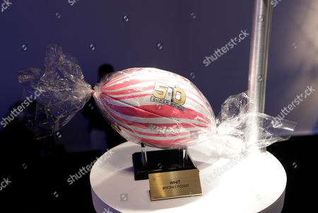A football designed by Whitney Pozgay is on display during the NFL/CFDA event at National Football League Headquarters in New York