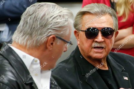 Bill Fralic, Mike Ditka Former Pittsburgh lineman Bill Fralic, left, talks with another Pittsburgh alumni, and former NFL coach Mike Ditka at a news conference for the retirement of the number 75 jersey for former Pittsburgh offensive lineman Jim Covert before an NCAA football game between the Pittsburgh and the Notre Dame, in Pittsburgh