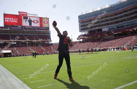 Golden State Warriors basketball player Andre Iguodala throws a football before an NFL football game between the San Francisco 49ers and the Green Bay Packers in Santa Clara, Calif
