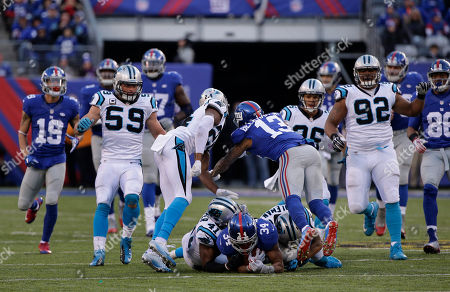 New York Giants' Odell Beckham (13) hits Carolina Panthers' Josh Norman (24) after teammate Shane Vereen (34) is tackled by Kurt Coleman (20) and Roman Harper (41) during the second half of an NFL football game, in East Rutherford, N.J