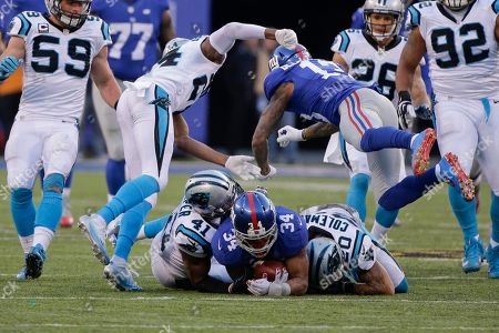Odell Beckham, Josh Norman New York Giants' Odell Beckham (13) hits Carolina Panthers' Josh Norman (24) after teammate Shane Vereen (34) is tackled by Kurt Coleman (20) and Roman Harper (41) during the second half of an NFL football game, in East Rutherford, N.J