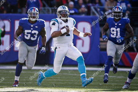 Cam Newton Carolina Panthers quarterback Cam Newton (1) slides in front of New York Giants' Jasper Brinkley (53) and Robert Ayers (91) during the first half of an NFL football game, in East Rutherford, N.J