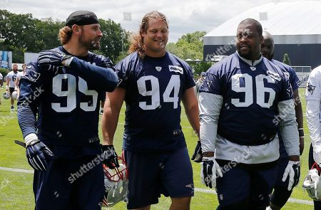 Chris Long, Markus Kuhn, Terrance Knighton New England Patriots defensive end Chris Long (95), defensive lineman Markus Kuhn (94) and Terrance Knighton (96) walk off the field following an NFL football practice, in Foxborough, Mass