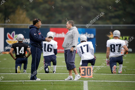 Mike Lombardi, Bill Belichick New England Patriots assistant to the coaching staff Mike Lombardi, left, speaks with head coach Bill Belichick, right, during an NFL football practice, in Foxborough, Mass. The New York Jets are to play the Patriots Sunday, Oct. 25 in Foxborough