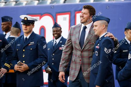 David Diehl Former New York Giants player David Diehl poses for photographs with members of the military before an NFL football game between the New York Giants and the New England Patriots, in East Rutherford, N.J