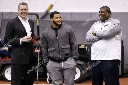 Scott Barnes, Aaron Donald, Sam Clancy Pittsburgh Atletic Director Scott Barnes, left, talks with Los Angeles Rams and former Pittsburgh defensive lineman Aaron Donald, center, and former Pittsburgh basketball star Sam Clancy, who went on to play defensive line in the NFL during the Pro Timing Day for Pitt's NFL draft prospects, in Pittsburgh