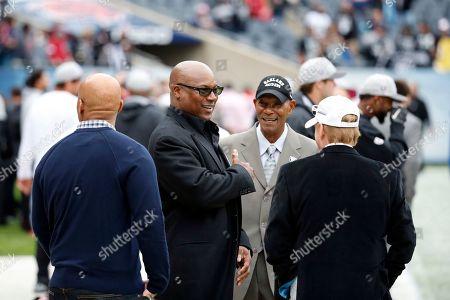 Bo Jackson, Willie Brown, Mark Davis Former NFL players Bo Jackson, left, and Willie Brown talks to Oakland Raiders owner Mark Davis, right, before an NFL football game, in Chicago