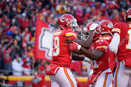 Jeremy Maclin, Jason Avant Kansas City Chiefs wide receiver Jeremy Maclin (19) celebrates his touchdown against the Oakland Raiders with wide receiver Jason Avant (81) during the first half of an NFL football game in Kansas City, Mo