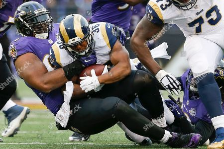 Chris Canty, Benny Cunningham Baltimore Ravens defensive end Chris Canty (99) tackles St. Louis Rams running back Benny Cunningham (36) during the second half of an NFL football game in Baltimore