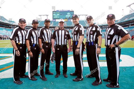 NFL referees The officials working the NFL football game between the Miami Dolphins and the Baltimore Ravens, in Miami Gardens, Fla. The are left to right: field judge Greg Gautreaux (80), head linesman Greg Bradley (98), field judge Jabir Walker (26), referee John Parry (132), umpire Mark Pellis (131), line judge Mark Perlman (9)back judge Perry Paganelli (46