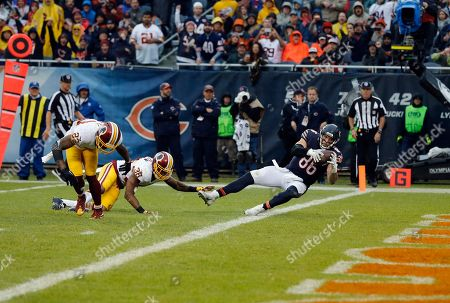 Zach Miller, Dashon Goldson Chicago Bears tight end Zach Miller (86) falls into the end zone for a touchdown against Washington Redskins free safety Dashon Goldson (38) during the second half of an NFL football game, in Chicago