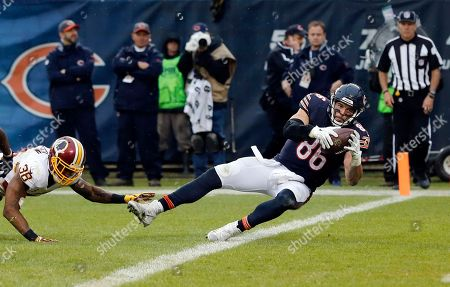 Zach Miller, Dashon Goldson Chicago Bears tight end Zach Miller (86) falls to the end zone for a touchdown against Washington Redskins free safety Dashon Goldson (38) during the second half of an NFL football game, in Chicago