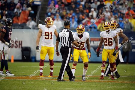 Stock Image of Greg Yette, Dashon Goldson Washington Redskins free safety Dashon Goldson (38) argues a call with back judge Greg Yette (38) during the second half of an NFL football game, in Chicago