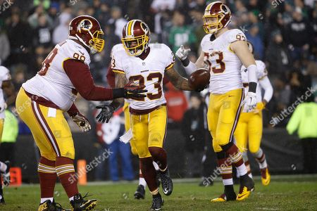 Washington Redskins' DeAngelo Hall (23) celebrates with Terrance Knighton (98) after scoring a touchdown on a fumble in the second half of an NFL football game against the Philadelphia Eagles, in Philadelphia