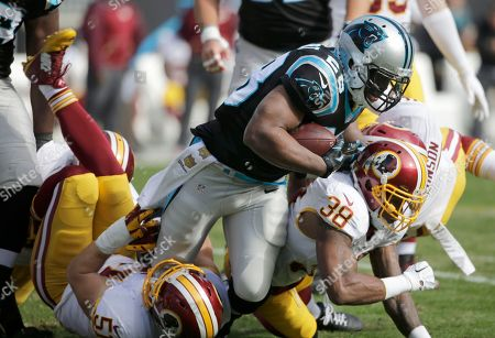 Jonathan Stewart, Terrance Knighton Carolina Panthers' Jonathan Stewart (28) is tackled by Washington Redskins' Terrance Knighton (98) in the first half of an NFL football game in Charlotte, N.C