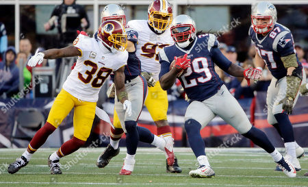 Dashon Goldson, LeGarrette Blount Washington Redskins safety Dashon Goldson (38) pursues New England Patriots running back LeGarrette Blount (29) during the second half of an NFL football game, in Foxborough, Mass