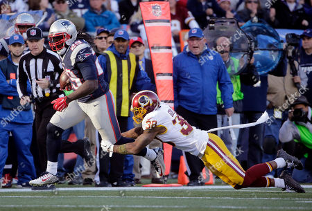 LeGarrette Blount, Dashon Goldson Washington Redskins safety Dashon Goldson (38) dives for New England Patriots running back LeGarrette Blount (29) during the second half of an NFL football game, in Foxborough, Mass