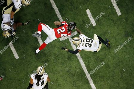 New Orleans Saints defensive back Kyle Wilson (24) works during the second half of an NFL football game between the Atlanta Falcons and the New Orleans Saints, in Atlanta. The New Orleans Saints won 20-17