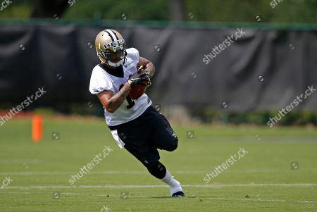 Reggie Bell New Orleans Saints wide receiver Reggie Bell (11) runs through drills during an NFL football practice in Metairie, La