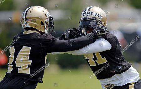 Roman Harper, Kyle Wilson New Orleans Saints safety Roman Harper (41) goes through drills against cornerback Kyle Wilson (24) during an NFL football practice in Metairie, La