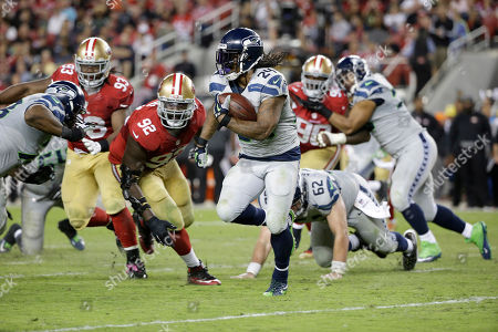 Marshawn Lynch, Quinton Dial Seattle Seahawks running back Marshawn Lynch (24) runs against San Francisco 49ers defensive end Quinton Dial (92) during the second half of an NFL football game in Santa Clara, Calif