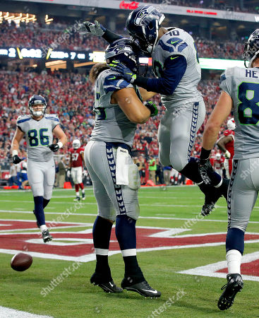 Will Tukuafu, Derrick Coleman Seattle Seahawks fullback Will Tukuafu (46) celebrates with teammate Derrick Coleman (40) after scoring a touchdown against the Arizona Cardinals during the first half of an NFL football game, in Glendale, Ariz