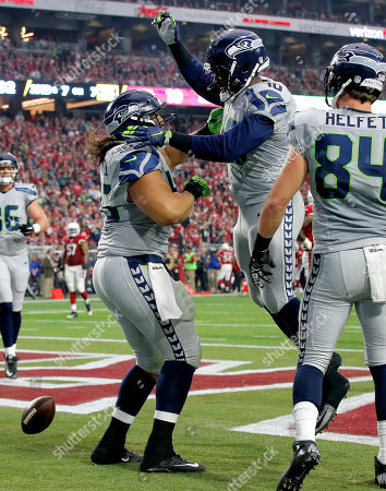 Will Tukuafu, Derrick Coleman, Cooper Helfet Seattle Seahawks fullback Will Tukuafu (46) celebrates with teammates Derrick Coleman (40) and Cooper Helfet (84) after scoring a touchdown against the Arizona Cardinals during the first half of an NFL football game, in Glendale, Ariz
