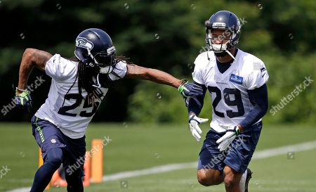 Richard Sherman, Earl Thomas Seattle Seahawks' Richard Sherman (25) and Earl Thomas (29) run through a drill at an NFL football practice, in Renton, Wash