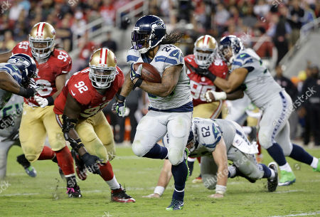 Marshawn Lynch, Quinton Dial Seattle Seahawks running back Marshawn Lynch (24) runs against San Francisco 49ers defensive end Quinton Dial (92) during the second half of an NFL football game in Santa Clara, Calif. Marshawn Lynch has rejoined the Seattle Seahawks just in time for the playoffs. Coach Pete Carroll said on his radio show Monday morning, Jan. 4, 2016, that Lynch was back at the team's facility after missing the final seven games of the regular season and undergoing abdominal surgery