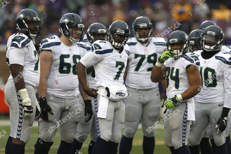 Tarvaris Jackson Seattle Seahawks quarterback Tarvaris Jackson (7) looks for a play from the sidelines while in the huddle against the Minnesota Vikings in the second half of an NFL football game in Minneapolis