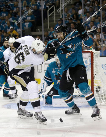 Stock Image of Eric Fehr, Brenden Dillon Pittsburgh Penguins right wing Eric Fehr (16) looks toward the puck next to San Jose Sharks defenseman Brenden Dillon during the first period of Game 3 of the NHL hockey Stanley Cup Finals in San Jose, Calif