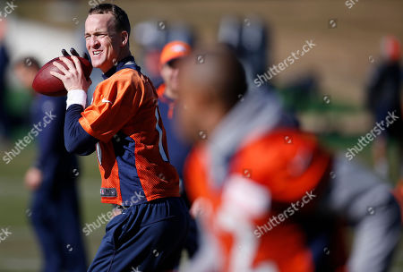 Peyton Manning, Andre Caldwell Denver Broncos quarterback Peyton Manning, back, looks to throw to wide receiver Andre Caldwell, front, during an NFL football practice at the team's headquarters, in Englewood, Colo. The Broncos are preparing to face the Carolina Panthers in the Super Bowl