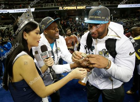 Miss Universe Pia Alonzo Wurtzbach speaks with Carolina Panthers wide receiver Stephen Hill, left and quarterback Joe Webb during Opening Night for the NFL Super Bowl 50 football game, in San Jose, Calif