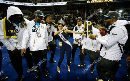 Miss Universe Pia Alonzo Wurtzbach dances with Carolina Panthers players during Opening Night for the NFL Super Bowl 50 football game, in San Jose, Calif