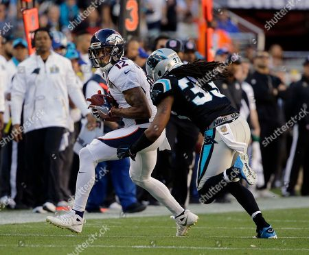 Denver Broncos' Andre Caldwell (12) is tackled by Carolina Panthers' Tre Boston (33) during the first half of the NFL Super Bowl 50 football game, in Santa Clara, Calif