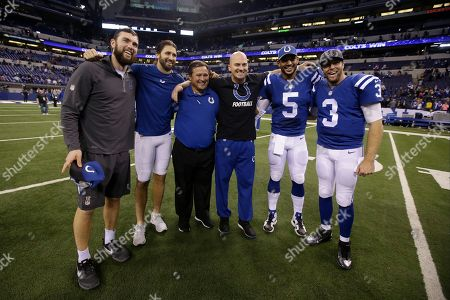 Clyde Christensen, Andrew Luck, Charlie Whitehurst, Matt Hasselbeck, Josh Freeman Ryan Lindley Indianapolis Colts quarterbacks, left to right, Andrew Luck, Charlie Whitehurst, quarterbacks coach Clyde Christensen, Matt Hasselbeck, Josh Freeman, and Ryan Lindley pose following an NFL football game in Indianapolis, . The Colts defeat the Titans 30-24