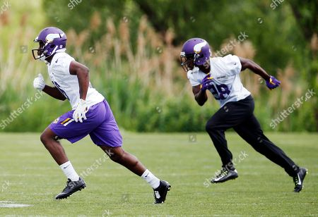 Stock Image of Tre Roberson, Keith Baxter Minnesota Vikings rookies cornerbacks Tre Roberson, left, and Keith Baxter go through running drills at NFL football minicamp, in Eden Prairie, Minn