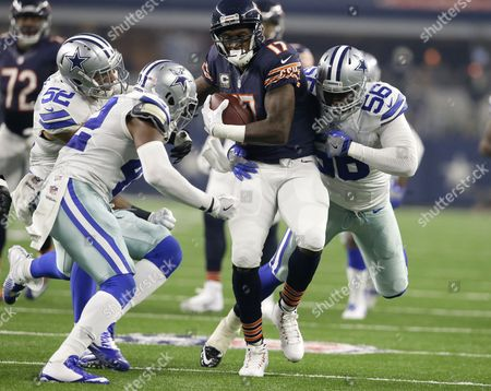 Stock Image of Alshon Jeffery, Andrew Gachkar, Justin Durant, Morris Claiborne Dallas Cowboys outside linebacker Andrew Gachkar (52), Morris Claiborne and Justin Durant (56) combine to stop Chicago Bears wide receiver Alshon Jeffery (17) Jeffery caught a pass in the first half of an NFL football game, in Arlington, Texas