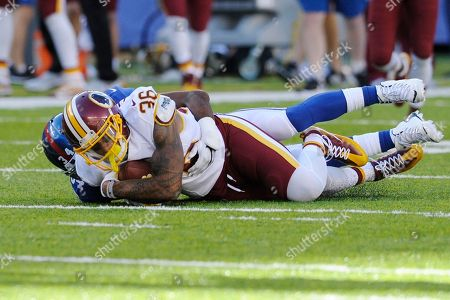 Stock Photo of Su'a Cravens Washington Redskins defensive back Su'a Cravens (36) is tackled by New York Giants' Shane Vereen (34) after intercepting a pass during the second half of an NFL football game, in East Rutherford, N.J