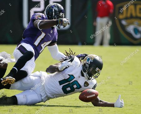 Denard Robinson, Devin Hester Jacksonville Jaguars' Denard Robinson (16) recovers a fumble on a punt as Baltimore Ravens' Devin Hester (14) tries to stop him during the second half of an NFL football game in Jacksonville, Fla