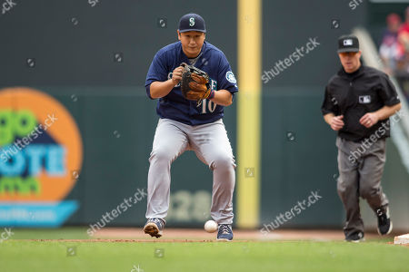 Dae-Ho Lee Seattle Mariners first baseman Dae-Ho Lee fields a ball hit by the Minnesota Twins in the third inning at a baseball game, in Minneapolis. The Mariners won 4-3