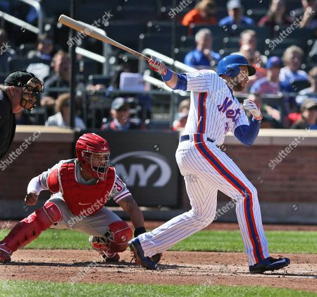 James Loney New York Mets' James Loney, right, watches his sacrifice infield hit during the second inning of a baseball game against the Philadelphia Phillies, in New York