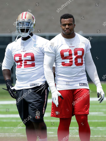 Quinton Dial, Lawrence Okoye San Francisco 49ers defensive ends Quinton Dial (92) and Lawrence Okoye (98) stand on the field during practice at an NFL football facility in Santa Clara, Calif