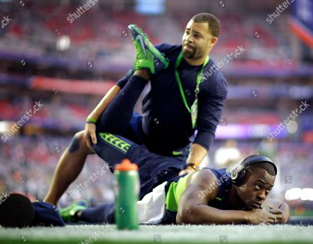 Tarvaris Jackson Seattle Seahawks quarterback Tarvaris Jackson, right, stretches before the NFL Super Bowl XLIX football game against the New England Patriots, in Glendale, Ariz