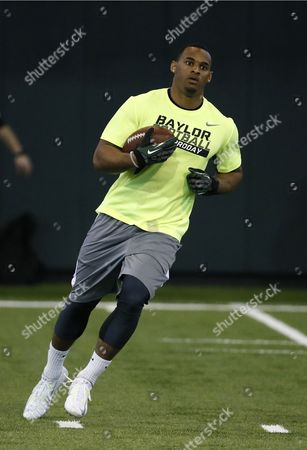 John Griffin John Griffin carries the ball as he works out for scouts at Baylor NFL football Pro Day in Waco, Texas