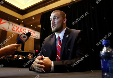 Stock Photo of Jordan Shelley Smith Kansas offensive lineman Jordan Shelley-Smith responds to questions during Big 12 Conference Football Media Days, in Dallas