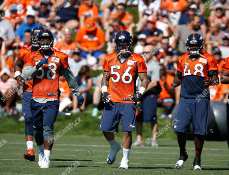 Von Miller, Shane Ray, Shaquiil Barrett From left, Denver Broncos outside linebackers Von Miller, Shane Ray and Shaquil Barrett run at the team's NFL football training camp, in Englewood, Colo