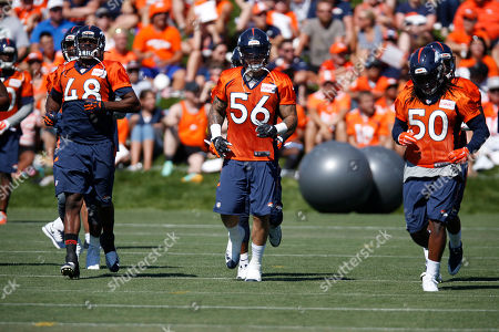 Shaquil Barrett, Shane Ray, Reggie Walker From left, Denver Broncos linebackers Shaquil Barrett, Shane Ray and Reggie Walker run at the team's NFL football training camp, in Englewood, Colo
